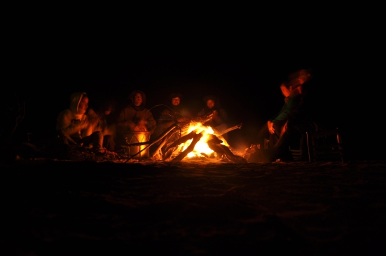 Tuaregs entertain underneath starry skies in the Sahara.